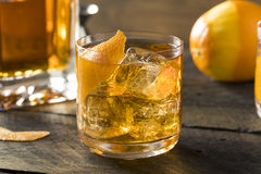 Boozy Homemade Old Fashioned Bourbon on the Rocks Stock Photography