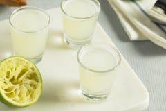 Boozy Lime  and Vodka Kamikaze Shots Royalty Free Stock Photography