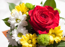 Boquet. Of blooming flowers focus on the rose stock photography