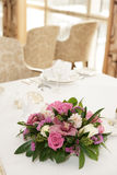 Boquet of orchid flowers and tulips. On arranged table royalty free stock images