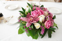 Boquet of orchid flowers and tulips. On arranged table royalty free stock photos