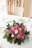 Boquet of orchid flowers and tulips. On arranged table stock photography