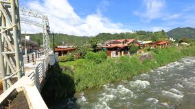 Boquete seen from the bridge on the Caldera river Panama. In a sunny day stock video footage