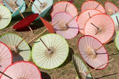 Bor sang Umbrella is Sun drying on floor Royalty Free Stock Images