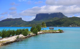 Bora Bora airport. View from Bora Bora airport. Beautiful palms, mountains and blue sea. French Polynesia, South Pacific Ocean stock photo