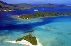 Bora Bora Island. Aerial View of Bora Bora with overwater Bungalows and cruise ships Royalty Free Stock Image