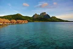 Bora Bora, Overwater Bungalows Mount Otemanu. Bora Bora, Overwater bungalows with Mount Otemanu in background in early morning sunlight royalty free stock images