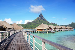 Bora Bora Paradise. Beautiful view of Mount Otemanu with the over-the-water bungalows in tropical paradise.  Perfect for advertising Bora Bora or sharing your Royalty Free Stock Images