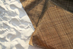 Boracay beach rattan mat and cushion on sand Stock Images