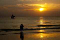 Boracay beach, Philippines. Lovers looking at the sunset stock photography