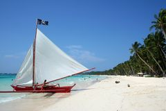 Boracay beach pirates paraw sailboat philippines. Paraw sailboat on white sand beaches of tropical boracay island in the philippines Royalty Free Stock Images