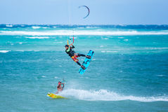 Boracay island, Philippines - January 25: two kiteboarders using rope tow while riding. One of them performing jump near Bulabog beach on January 25, 2016 Stock Image