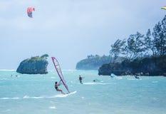 Boracay island, Philippines - January 26: windsurfers and kiteboarders enjoying wind power on Bulabog beach Royalty Free Stock Photo