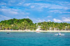 Hopping Tour boats with white beach from the water. BORACAY ISLAND, PHILIPPINES - November 18, 2017 : Hopping Tour boats with white beach from the water Stock Photography