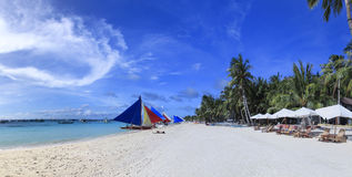 Boracay island white beach philippines. Panoramic view of colorful paraw sail boats along white beach on boracay island in the philippines Stock Photo