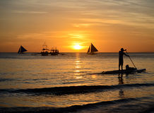 Boracay sunset. Paddleboarding during sunset in Boracay, Philippines royalty free stock photography
