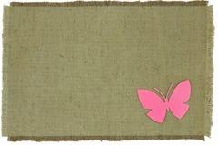 Borboleta caseiro do cartão no pano grosseiro verde Imagens de Stock Royalty Free