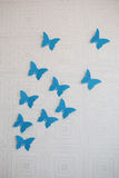 Borboleta do papel azul na parede Fotografia de Stock Royalty Free