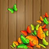 Borboletas coloridas no fundo de madeira Imagens de Stock