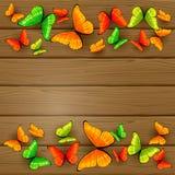 Borboletas coloridas no fundo de madeira Fotografia de Stock