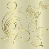 Borboletas em um fundo do ouro imagem de stock royalty free