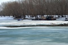 The Borcea arm froze. Boats and pontoons are under the snow Stock Image