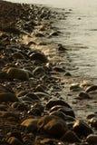 Bord de la mer au coucher du soleil Image stock