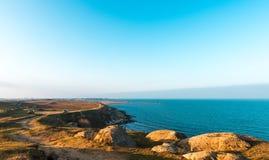Bord de la mer dans le temps de coucher du soleil Images libres de droits