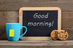 Bord met Goedemorgen! uitdrukking Stock Foto's