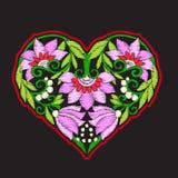 Bordado con el corazón modelado del amor en fondo negro Imagen de archivo