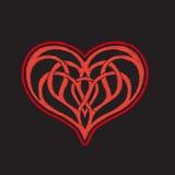 Bordado con el corazón modelado del amor en fondo negro Imagen de archivo libre de regalías