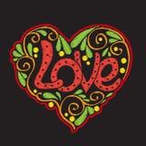 Bordado con el corazón modelado del amor en fondo negro Foto de archivo