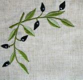 Bordado do ramo de oliveira na tela bege de linho Fotos de Stock Royalty Free