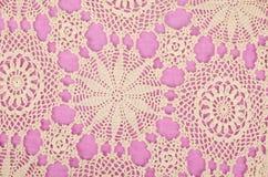 Bordado en fondo púrpura fotografía de archivo libre de regalías