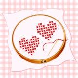 Bordado rojo de dos corazones Imagen de archivo