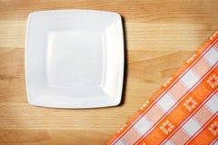 Bordduk på trätabellbakgrund Fotografering för Bildbyråer