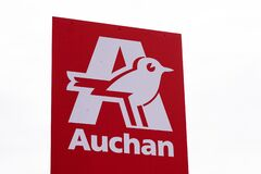 Auchan logo and red sign market store supermarket French grocery retailer shop