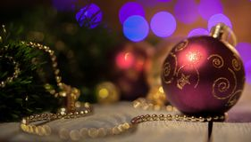 Bordeaux Christmas ball with a pattern. On the background bokeh royalty free stock photos