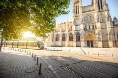 Bordeaux city in France. Morning view on the beautiful saint Pierre cathedral with modern tram in Bordeaux city, France stock photo
