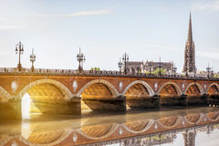 Bordeaux city in France. View on the famous saint Pierre bridge with saint Michael cathedral in Bordeaux city, France royalty free stock image