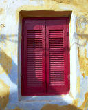 Bordeaux closed window shutters Royalty Free Stock Photo