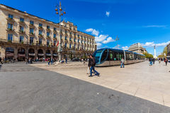 BORDEAUX, FRANCE - APRIL 4, 2011: Modern tram crossing Grand The Stock Photo