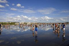 Summer days. BORDEAUX, FRANCE: Bordeaux water mirror full of people in one of the hotest summer days, having fun in the water, in Bordeaux, France stock photography