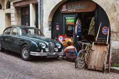 Woman searching through items outside shop in Bordeaux, France royalty free stock image
