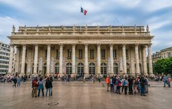 Bordeaux, France, 8 may 2018 - Tourist and locals walking on the. Main square `Place de La Comedie` passing the grand Opera House `Grand Théâtre de Bordeaux stock image