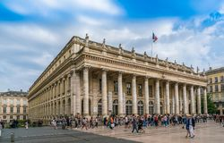 Bordeaux, France, 8 may 2018 - Tourist walking on the Main squar. E `Place de La Comedie` passing the grand Opera House `Grand Théâtre de Bordeaux royalty free stock images