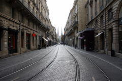 Bordeaux, France, October 18, 2011: Vital  Carles street with tramway rails and  Saint Andre church in the background. Bordeaux, France, October 18, 2011 Stock Image