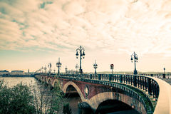 Bordeaux river bridge with St Michel cathedral Stock Photography