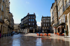 Bordeaux square with cafe. And buildings in winter stock images