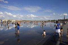 Summer days. Bordeaux water mirror full of people in one of the hotest summer days, having fun in the water, in Bordeaux, France royalty free stock photo